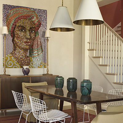 In The Dining Area A Simple Table Is Highlighted By 2 Large Pendants Scale Artwork Undeniable Focal Point Of This