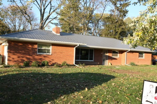 Brick house with metal roof quotes for Red brick house with metal roof