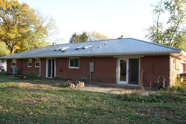 House tweaking for Metal roof pictures brick house