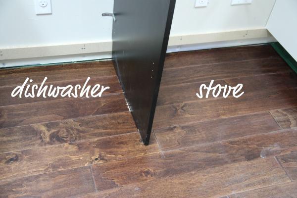 House Tweaking, Install Flooring Around Kitchen Cabinets