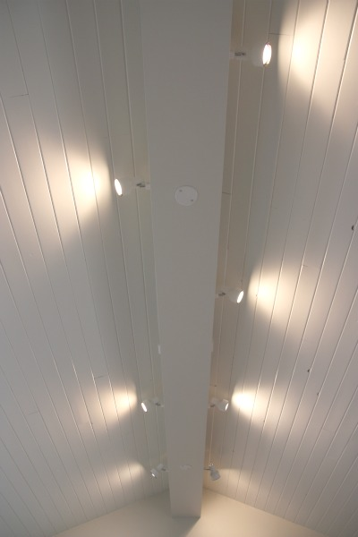 Along The Ridge Beam, We Chose To Have Track Lighting Installed To Wash The  Vaulted Ceiling With Light And Provide Indirect Ambiance Over The Great  Room.